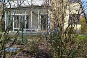 Aussenansicht mit Wintergarten - Sonnige Gartenwohnung in Bestlage von Solln