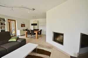 Modernisierte Doppelhaushälfte Grasbrunn - Wohnzimmer mit Kamin