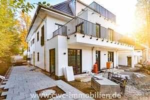 Erstbezug — Exklusive 3-Zi.-Architektenwohnung mit luxuriösen Südostterrassen